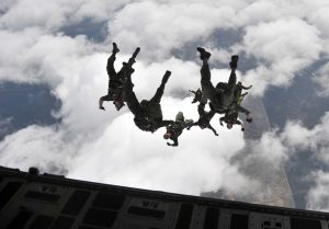 Canadian special operation regiment members conduct a freefall jump out of a U.S. Air Force C-17 Globemaster III during Emerald Warrior 2013, Hurlburt Field, Fla., April 28. The primary purpose of Emerald Warrior is to exercise special operations components in urban and irregular warfare settings to support combatant commanders. Emerald Warrior leverages lessons from Operation Iraqi Freedom,Operation Enduring Freedom and other historical lessons to provide better trained and ready forces to combatant commanders. (U.S. Air Force photo by Senior Airman Matthew Bruch)(Released)